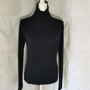 Form fitting long sleeve turtle neck,  size medium